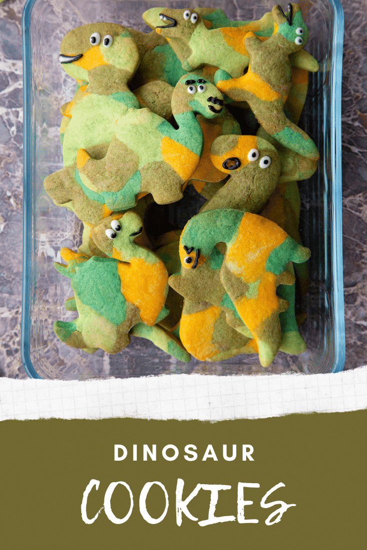 graphic text step-by-step recipe DINOSAUR COOKIES above Overhead shot of dinosaur sugar cookies in a glas dish with website URL below