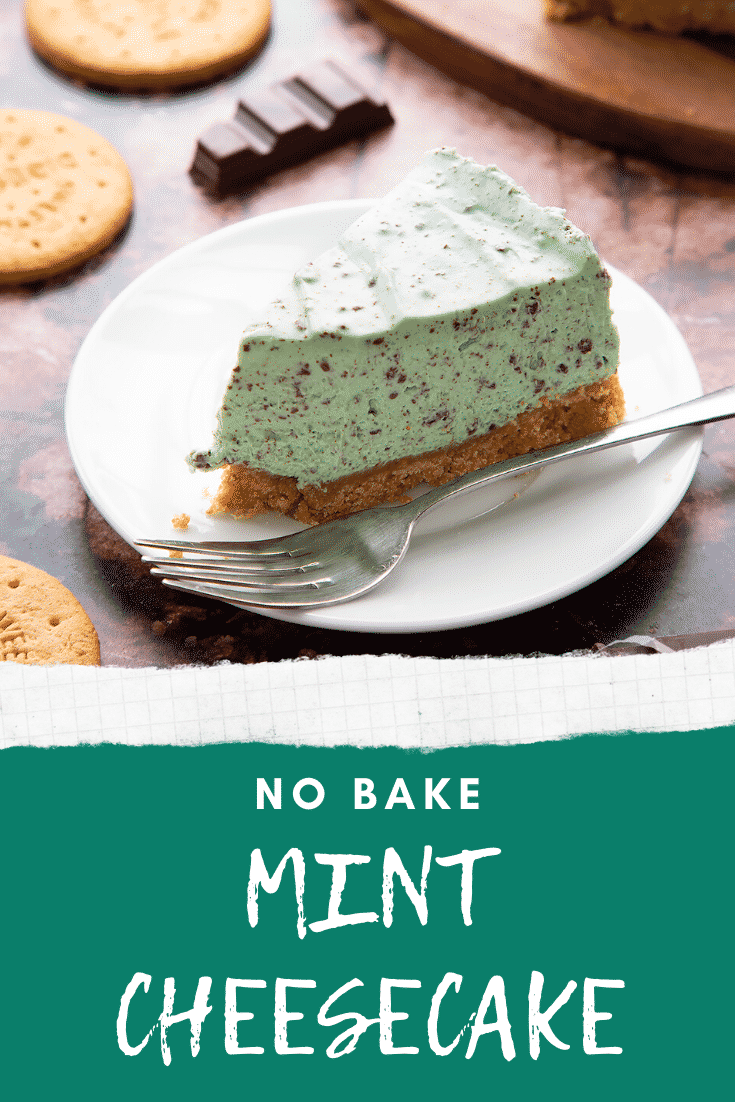 A slice of no bake mint cheesecake with a biscuit base on a white plate with a fork. Caption reads: no bake mint cheesecake