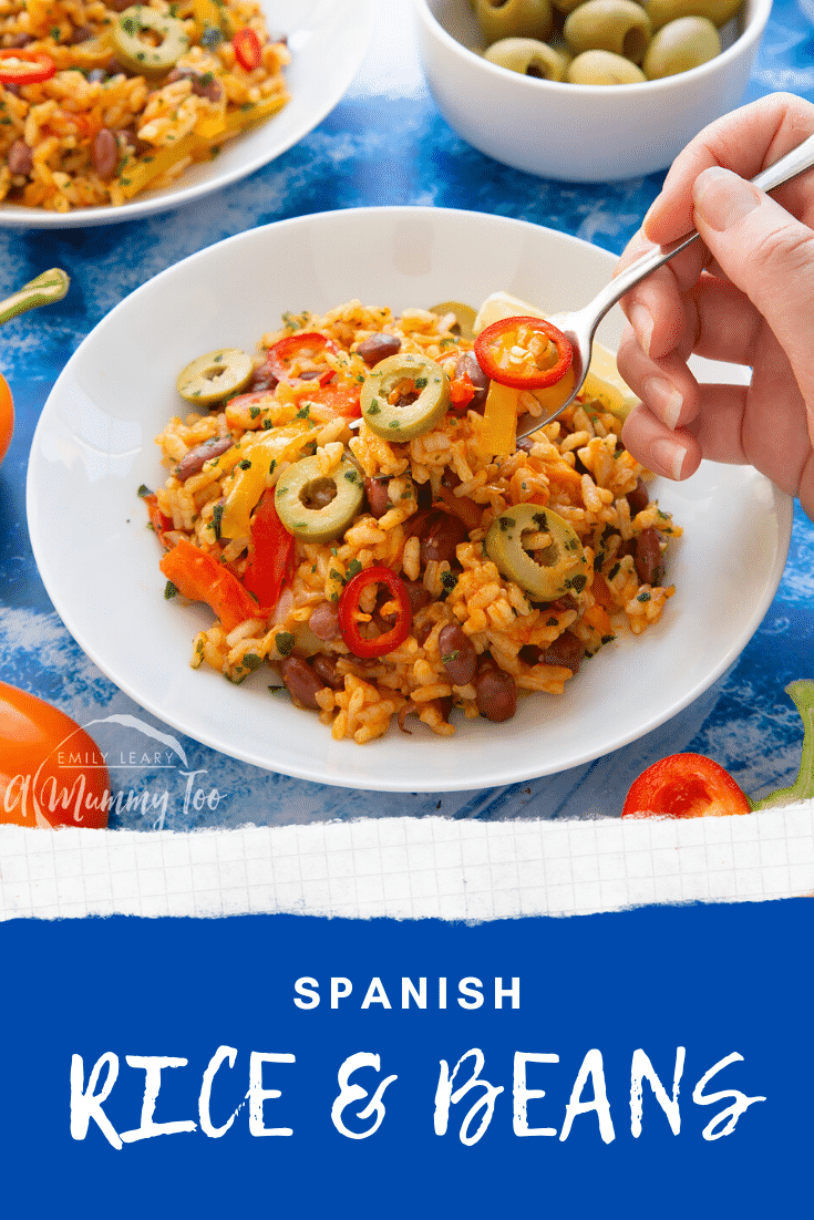 Easy Spanish rice and beans served in a shallow white bowl with a fork digging in. Caption reads: Spanish rice and beans