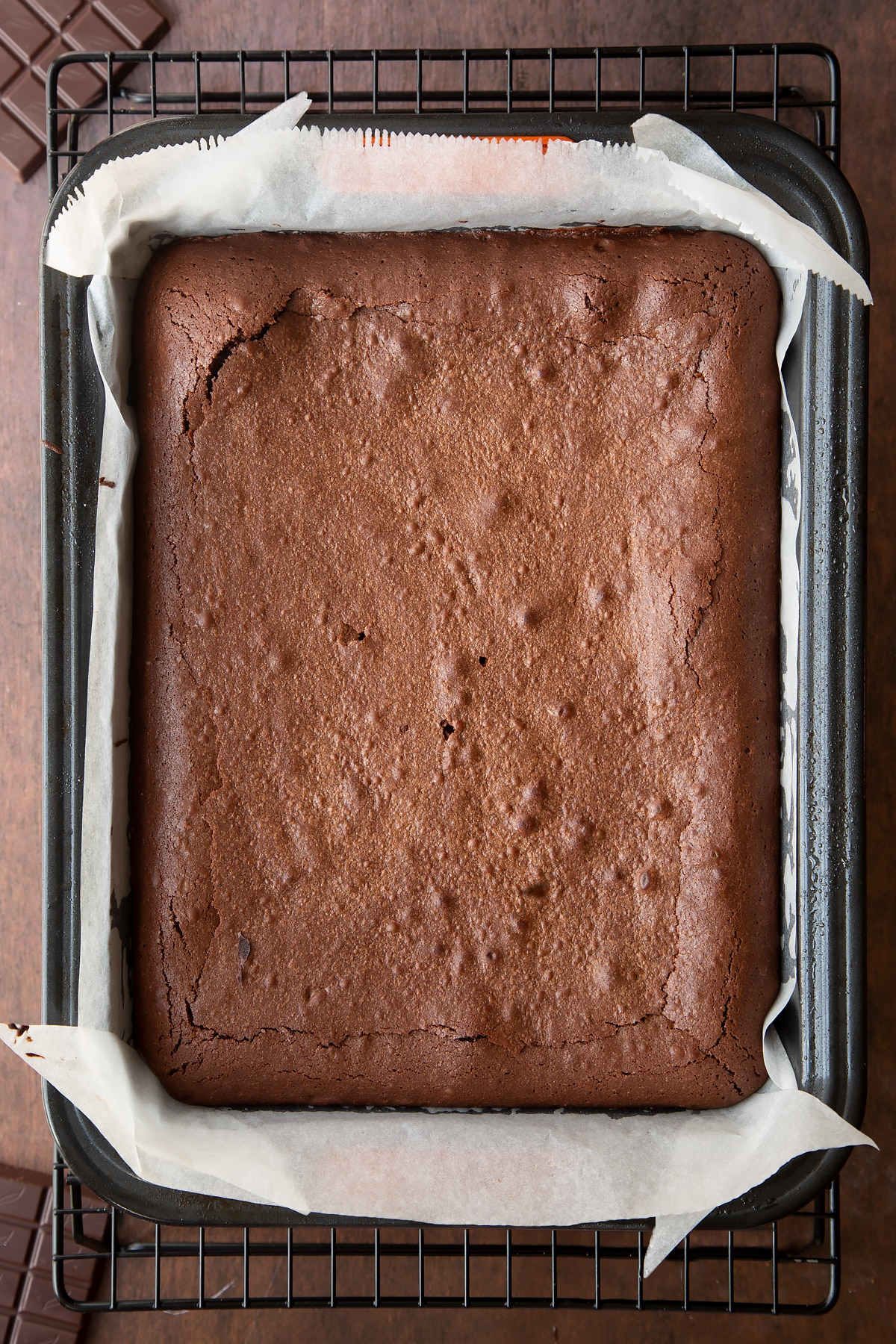 Freshly baked candy cane brownies in a lined tin.