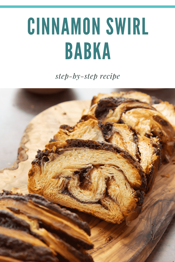 Slices of cinnamon swirl babka on a wooden board. Caption reads: cinnamon swirl babka step-by-step recipe