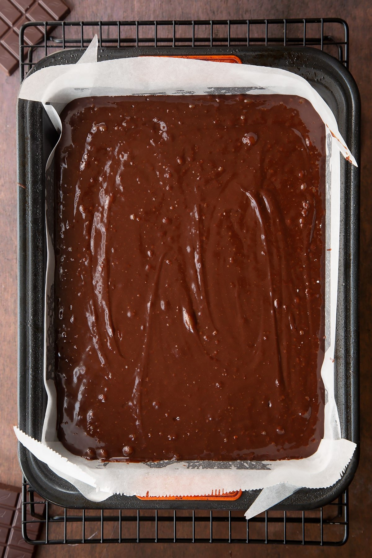 Halloween brownie batter in a greased and lined baking tin.