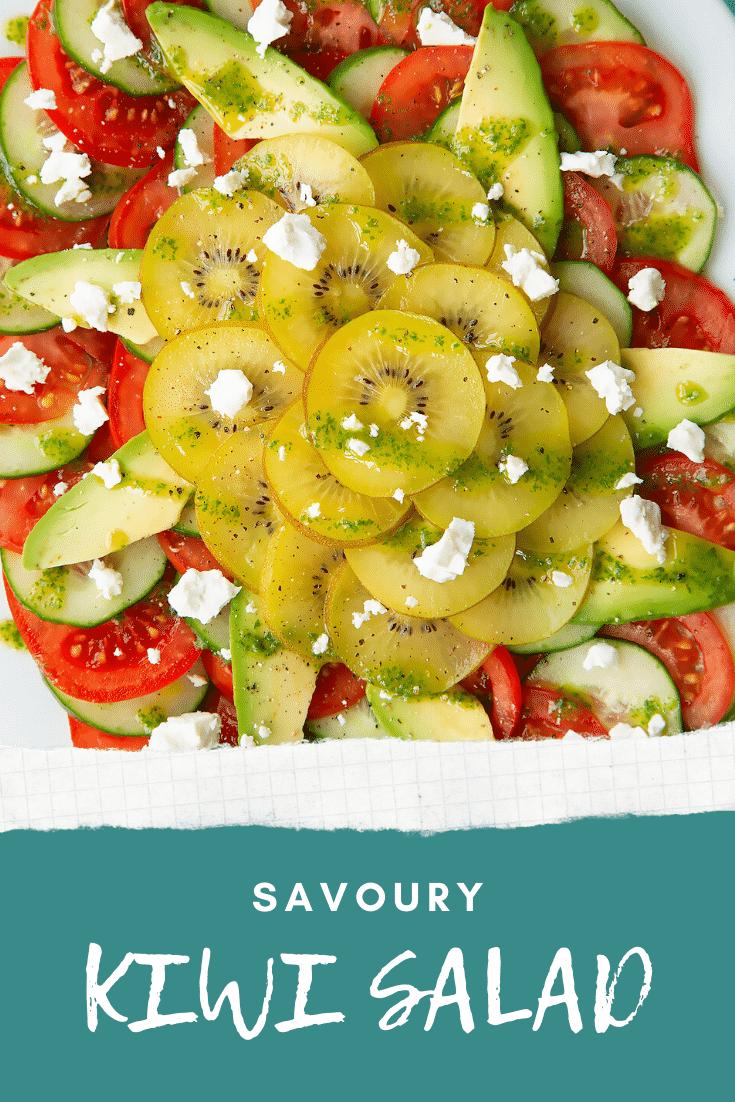 Close up from above of a kiwi feta salad on an oval white platter. Caption reads: Savoury kiwi salad.