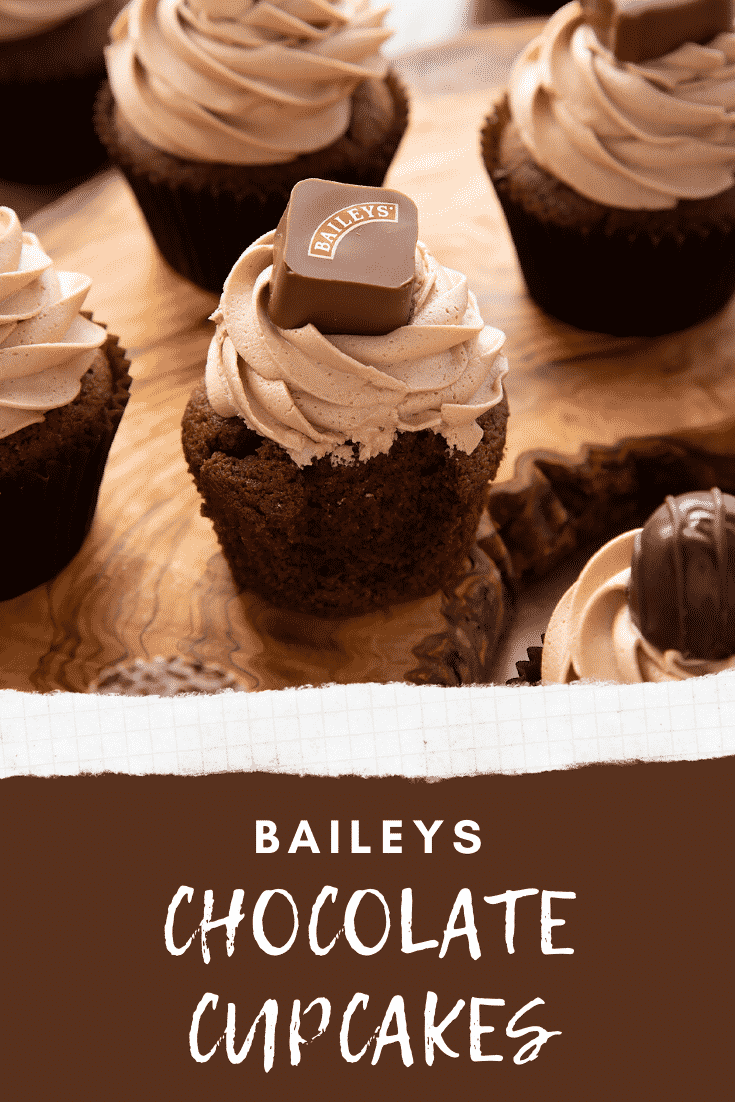 Baileys chocolate cupcake on a board with a bite out of it. Caption reads: Baileys chocolate cupcakes.