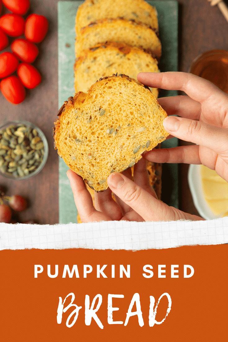 Hands holding a slice of pumpkin seed bread. Caption reads: Pumpkin seed bread.