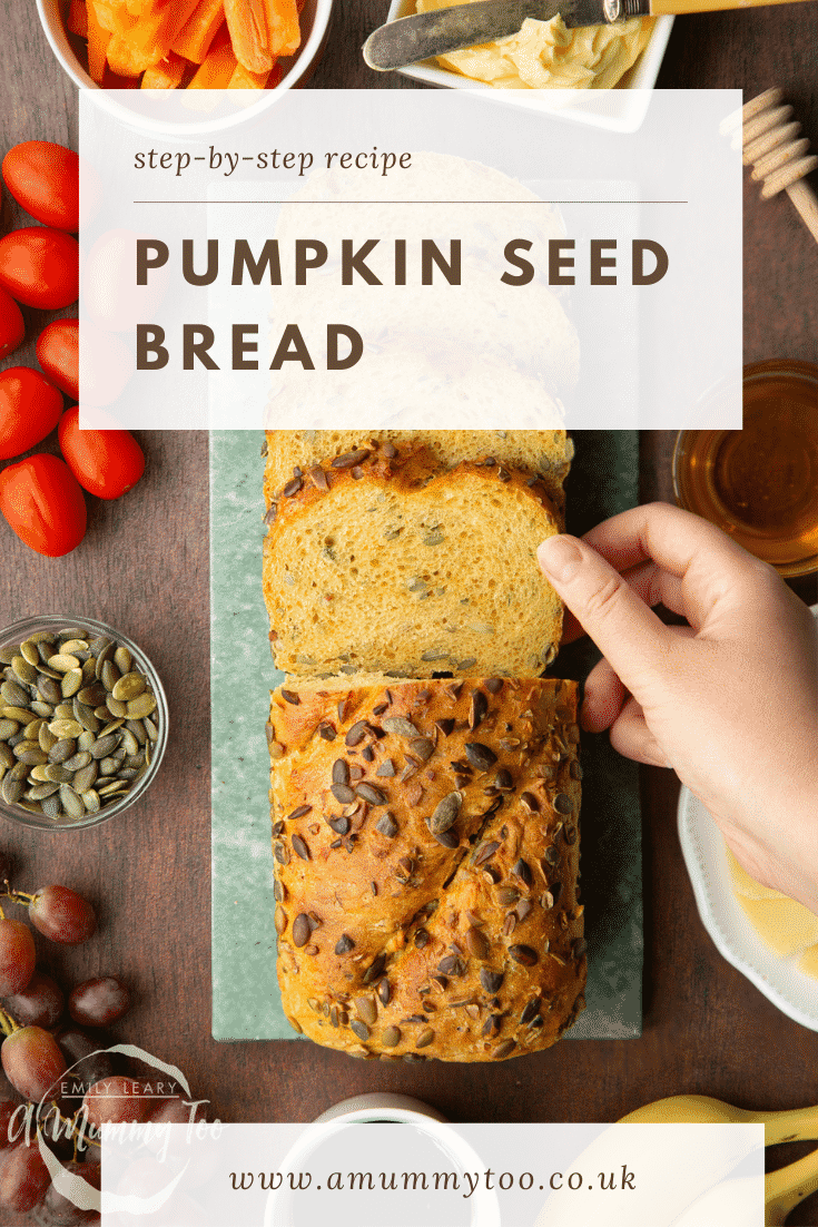 Sliced loaf of pumpkin seed bread on a marble board. a hand reaches for a slice. Caption reads: Step-by-step recipe pumpkin seed bread.
