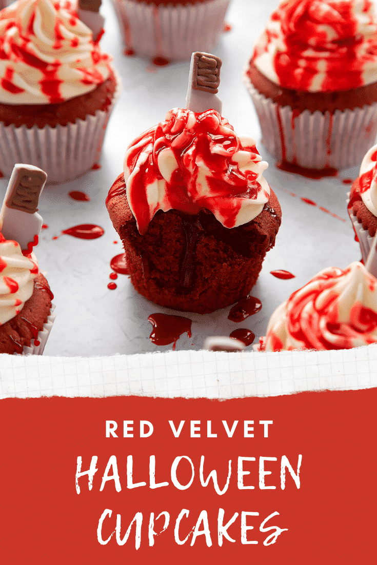 Red velvet Halloween cupcake, spattered with red syrup, with a bite out of it. Caption reads: Red velvet Halloween cupcakes.