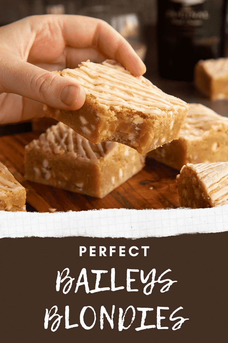 Hand holding a Baileys blondie with a bite out of it. Caption reads: Perfect Baileys blondies.