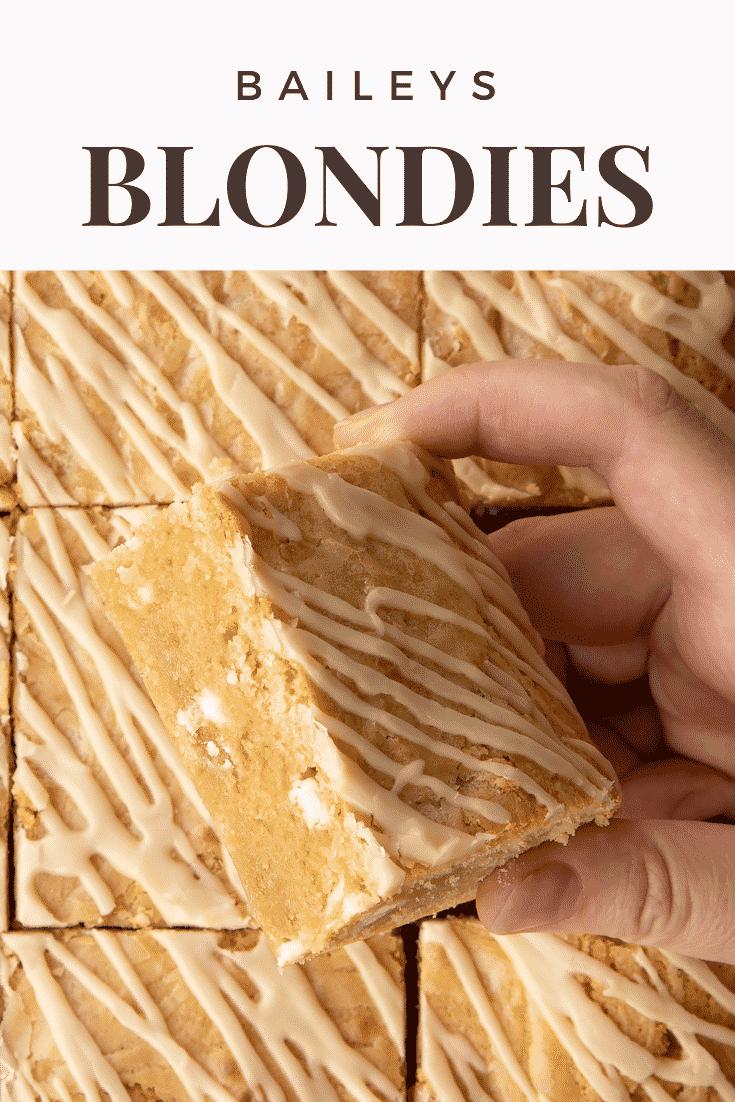 Hand holding a Baileys blondie. Caption reads: Baileys blondies.