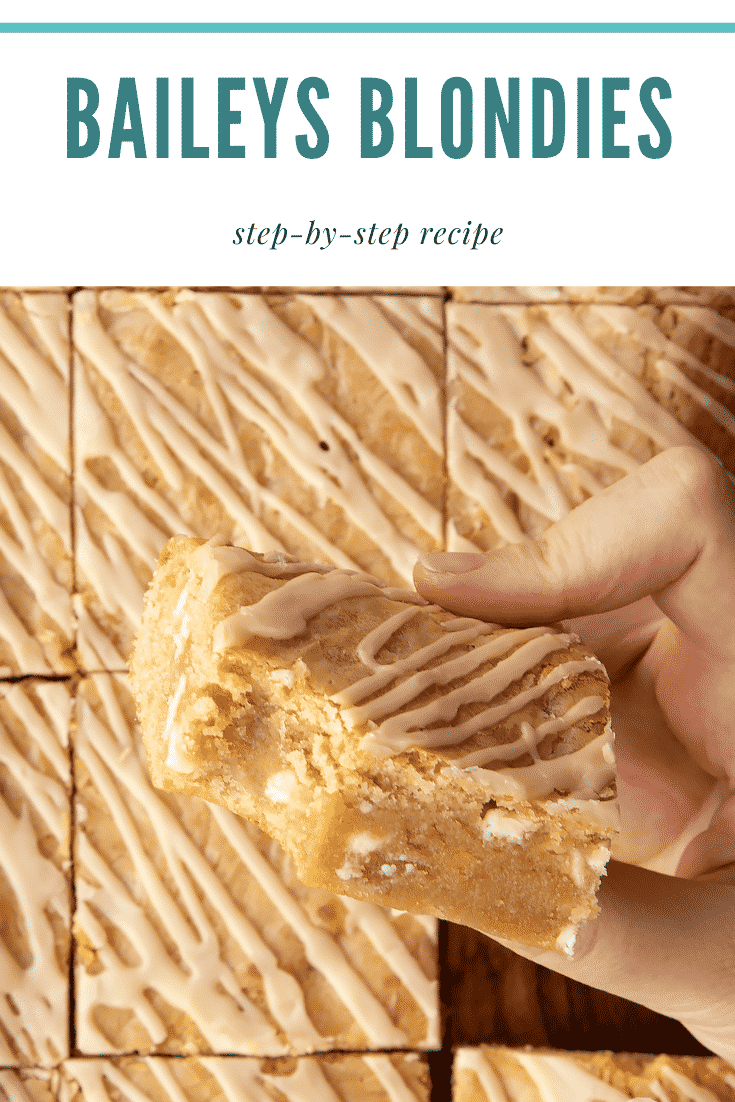 Hand holding a Baileys blondie with a bite out of it. Caption reads: Baileys blondies. Step-by-step recipe