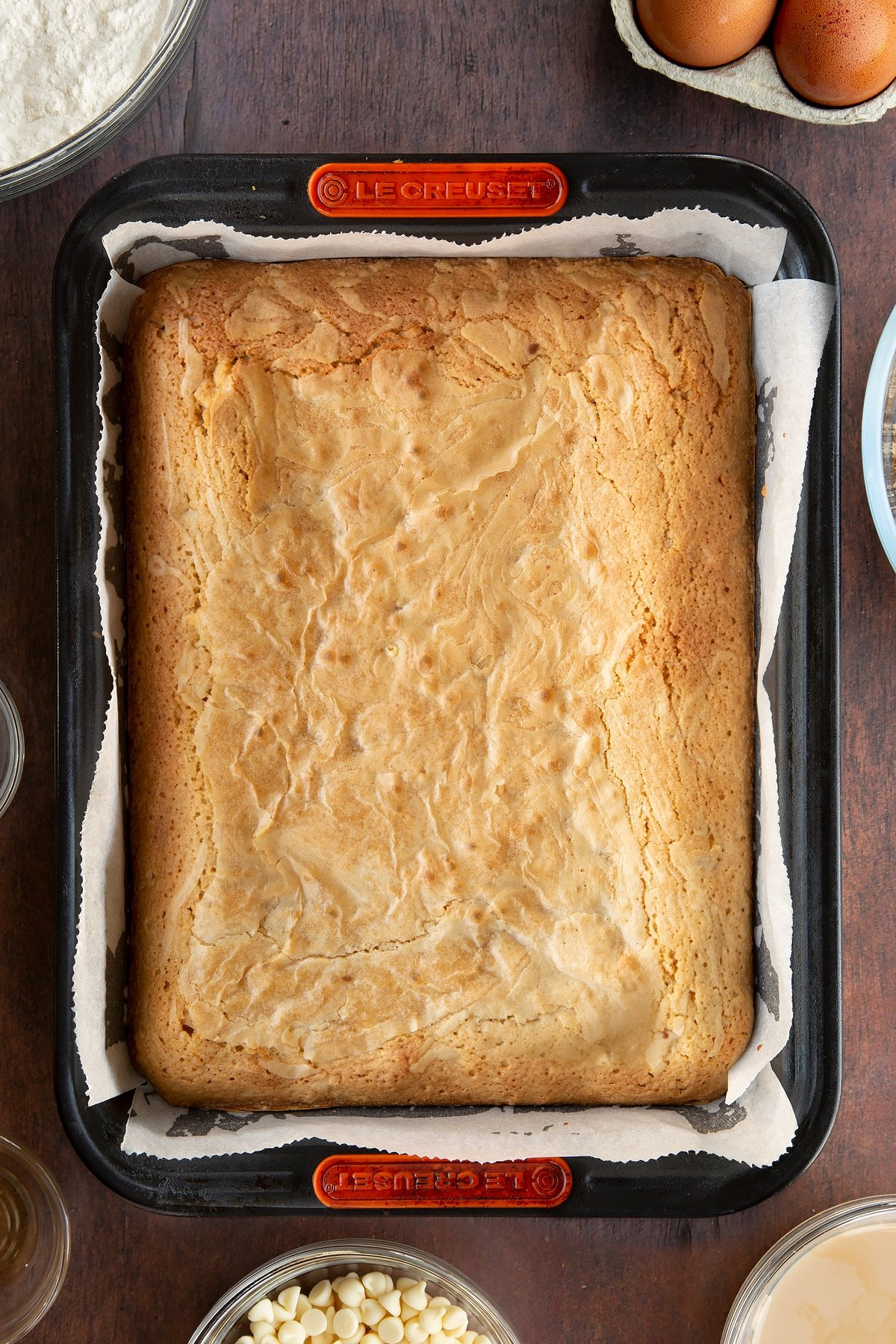 Freshly baked Baileys blondie in a lined tin.