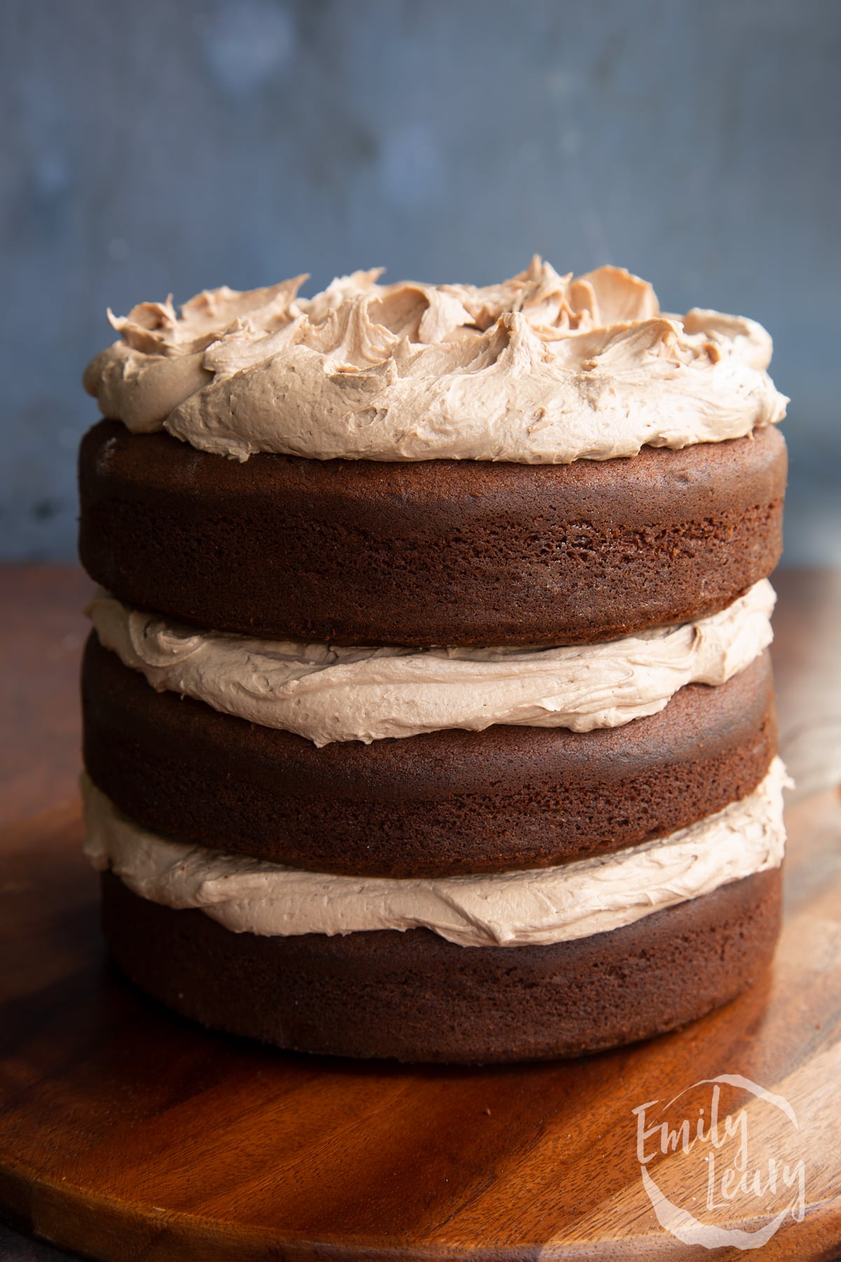 Three tier chocolate Baileys cake, sandwiched and topped with Baileys buttercream frosting.