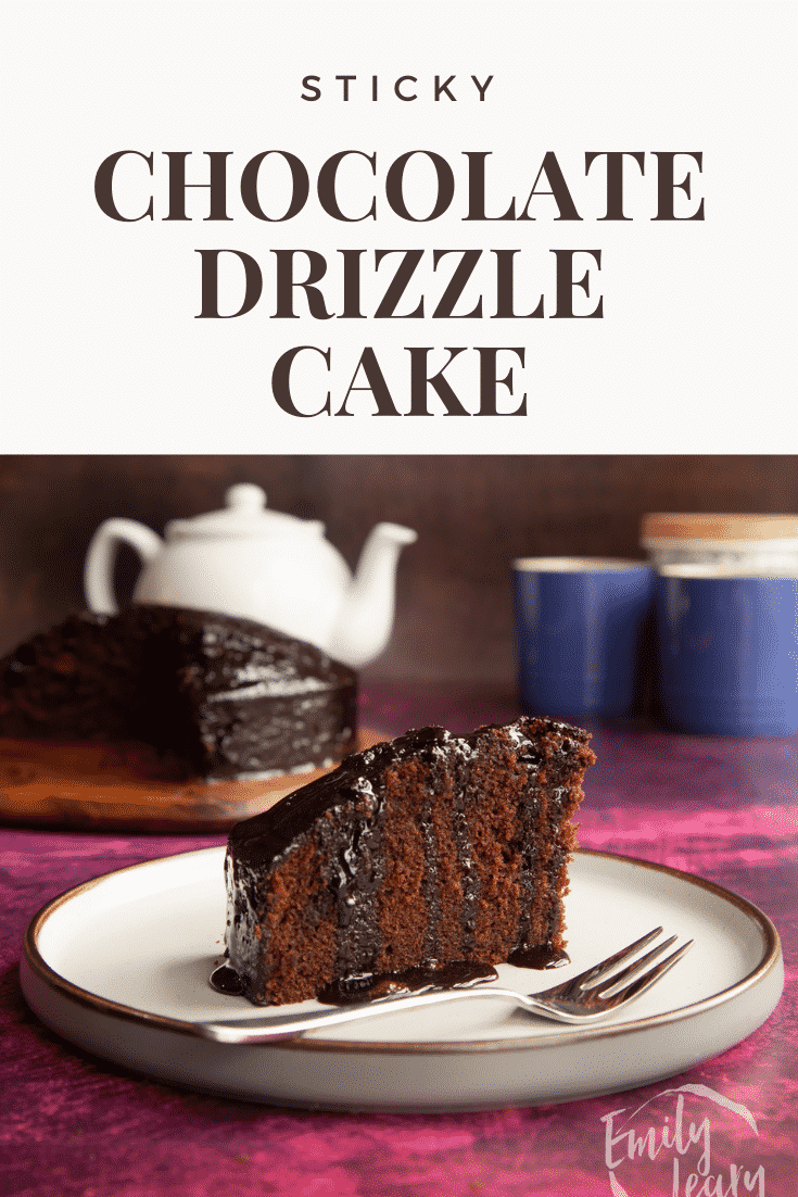 A slice of chocolate drizzle cake on a plate with a fork. Caption reads: Sticky chocolate drizzle cake.