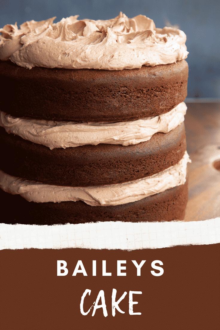 Chocolate Baileys cake with Baileys buttercream frosting on a board. Caption reads: Baileys cake.