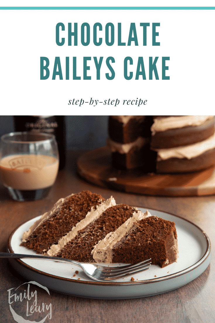 Slice of chocolate Baileys cake with Baileys buttercream frosting on a white plate with a fork. Caption reads: Chocolate Baileys cake. Step-by-step recipe.