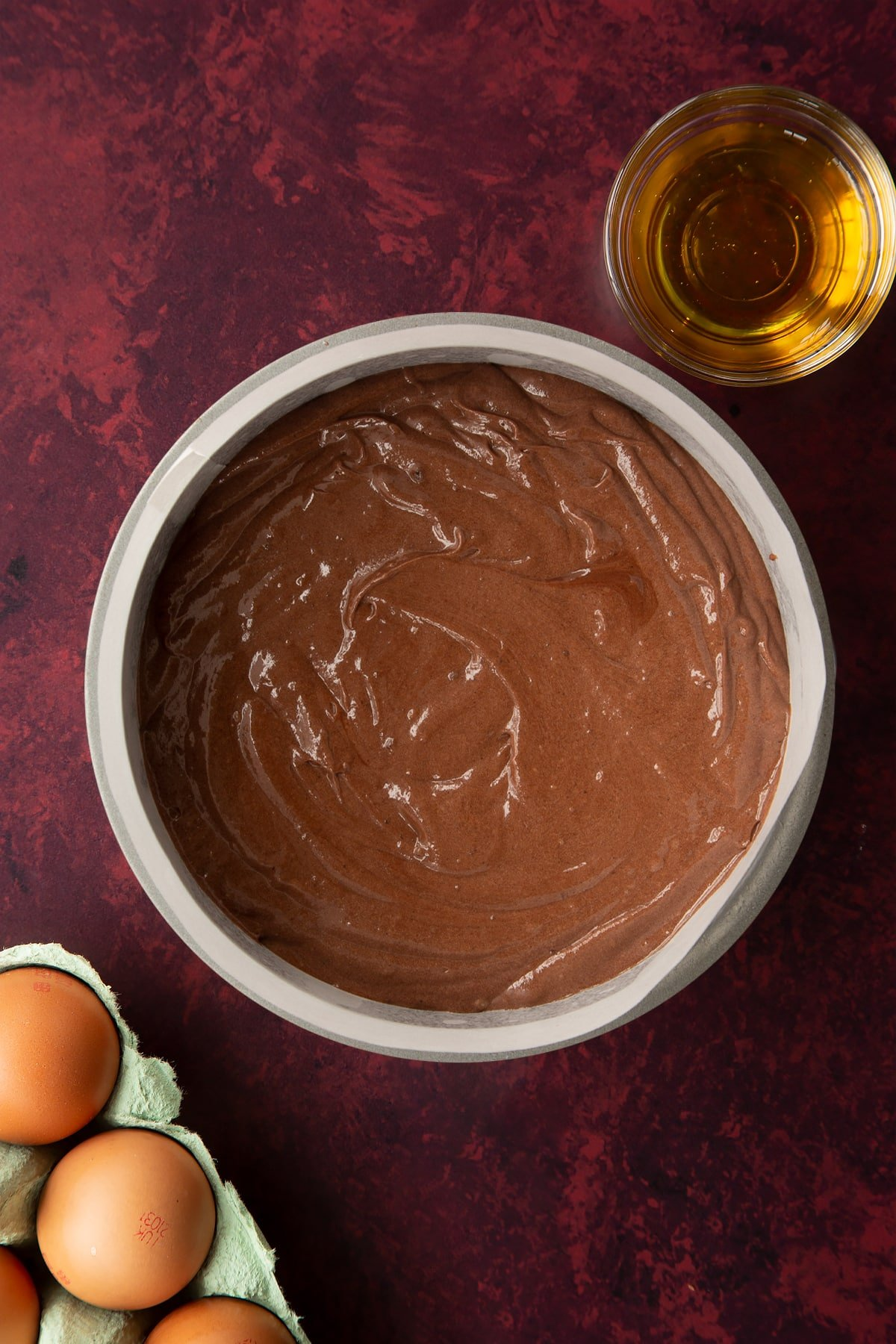 Chocolate drizzle cake batter in a lined tin.