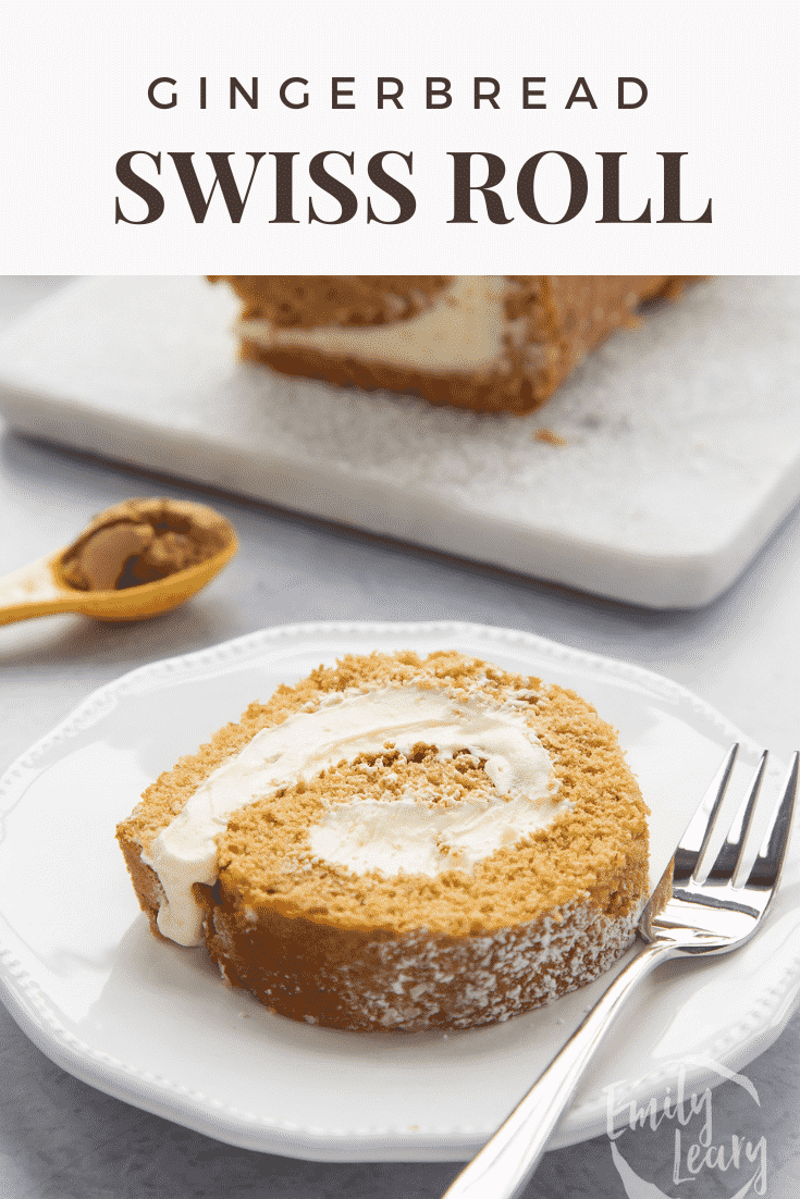 A slice of gingerbread Swiss roll on a white plate with a fork. Caption reads: Gingerbread Swiss roll.