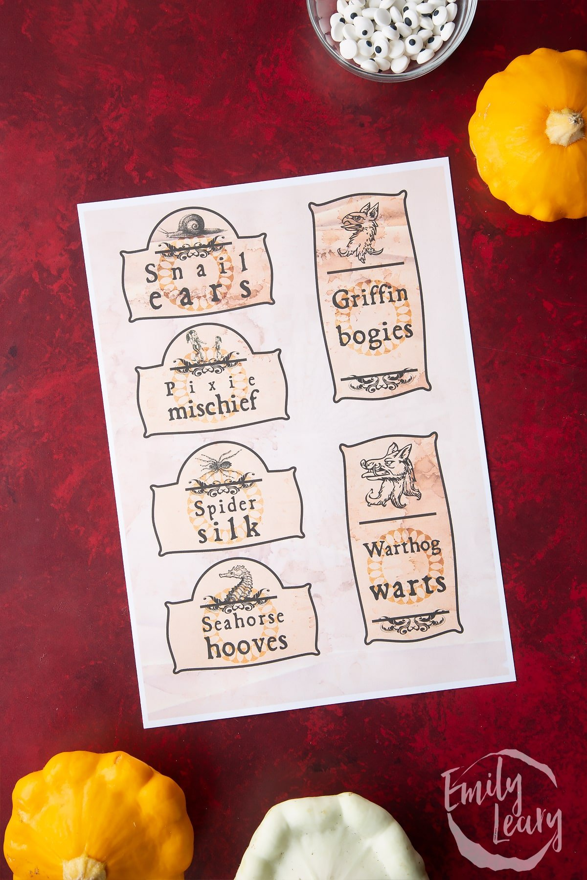 A printable sheet of Halloween apothecary labels on a red background.