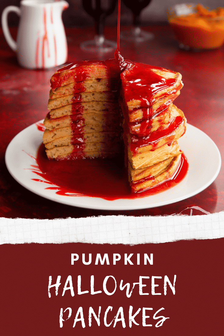 Halloween pancakes stacked on a white plate, drizzled with red syrup and a slice cut out. Caption reads: Pumpkin Halloween pancakes.