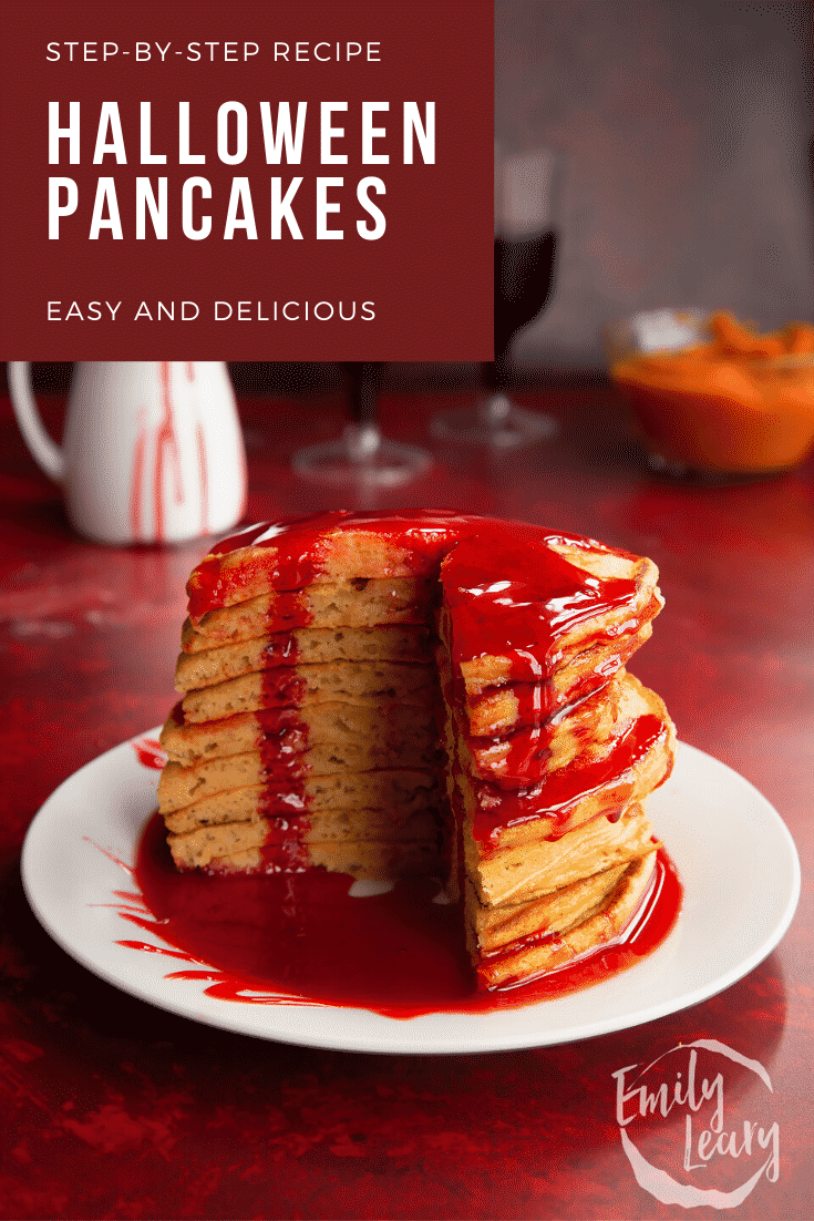 Halloween pancakes stacked on a white plate, drizzled with red syrup. A section has been cut away. Caption reads: Step-by-step recipes. Halloween pancakes. Easy and delicious.