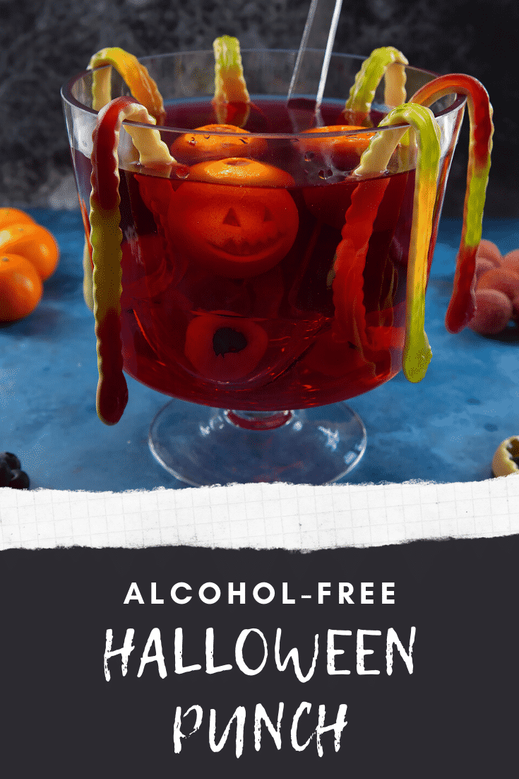 Halloween punch, decorated with fruit and gummy snakes. Caption reads: Alcohol free Halloween punch.