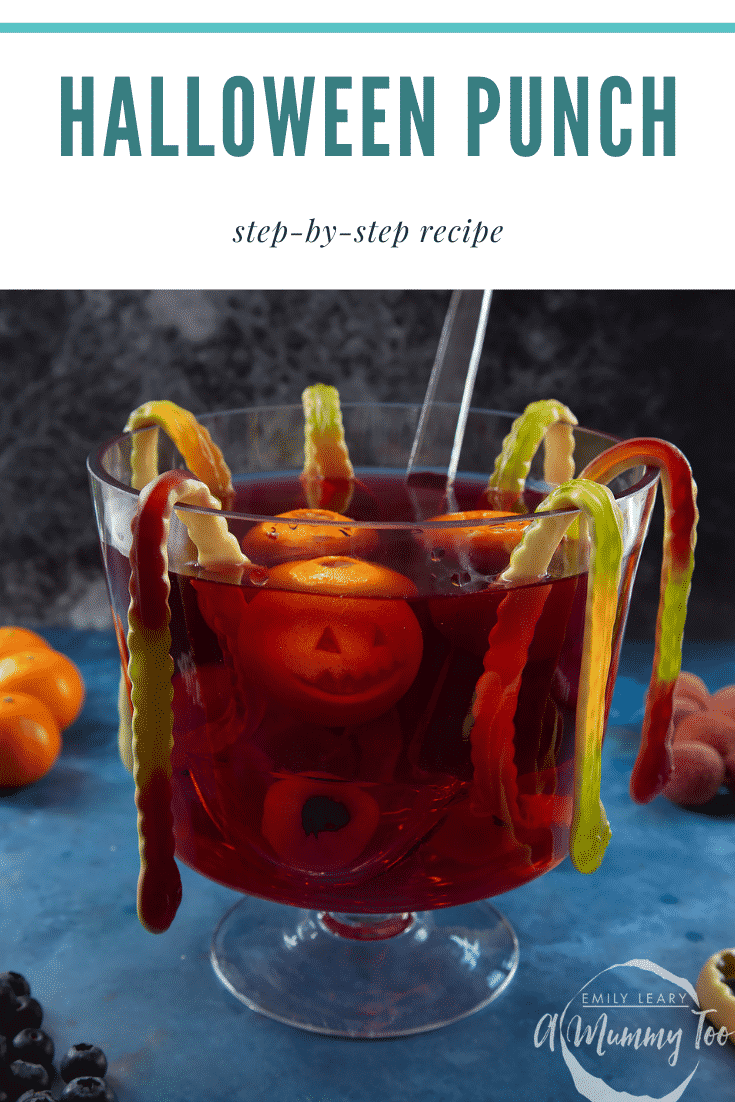 Halloween punch, decorated with fruit and gummy snakes. Caption reads: Halloween punch step-by-step recipe.