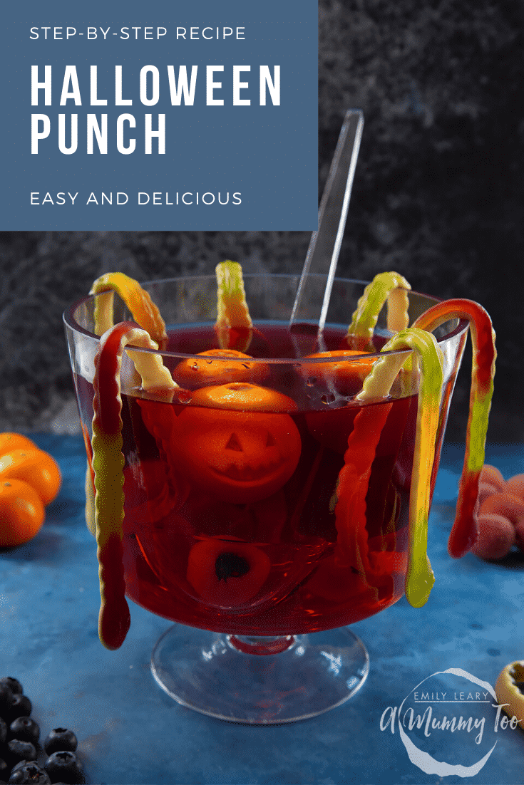 Halloween punch, decorated with fruit and gummy snakes. Caption reads: Step-by-step recipe Halloween punch. Easy and delicious.