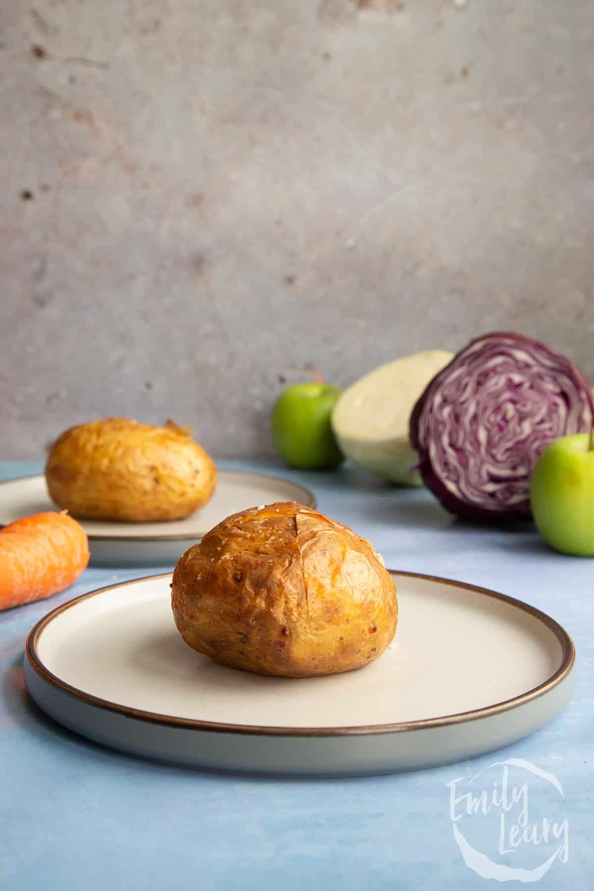 Baked potato on a plate.