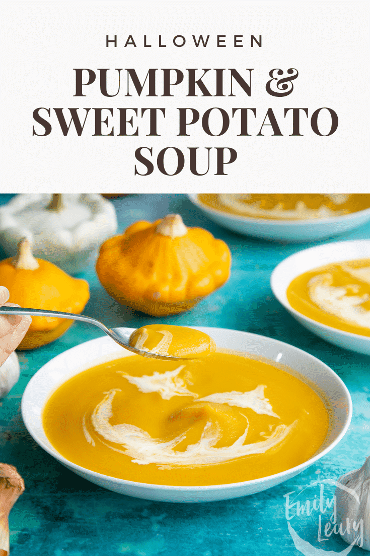 Pumpkin and sweet potato soup in a white bowl. The soup has cream swirled on top to resemble a jack'o'lantern. A hand holds a spoon, lifting some soup. Caption reads: Halloween Pumpkin and sweet potato soup