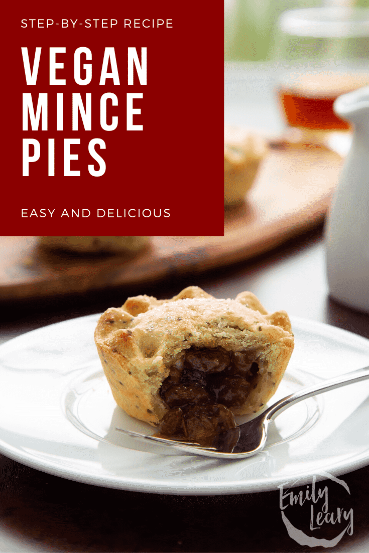Vegan mince pies on a white plate. It is broken open with a fork. Caption reads: Step-by-step recipe. Vegan mince pies. Easy and delicious.