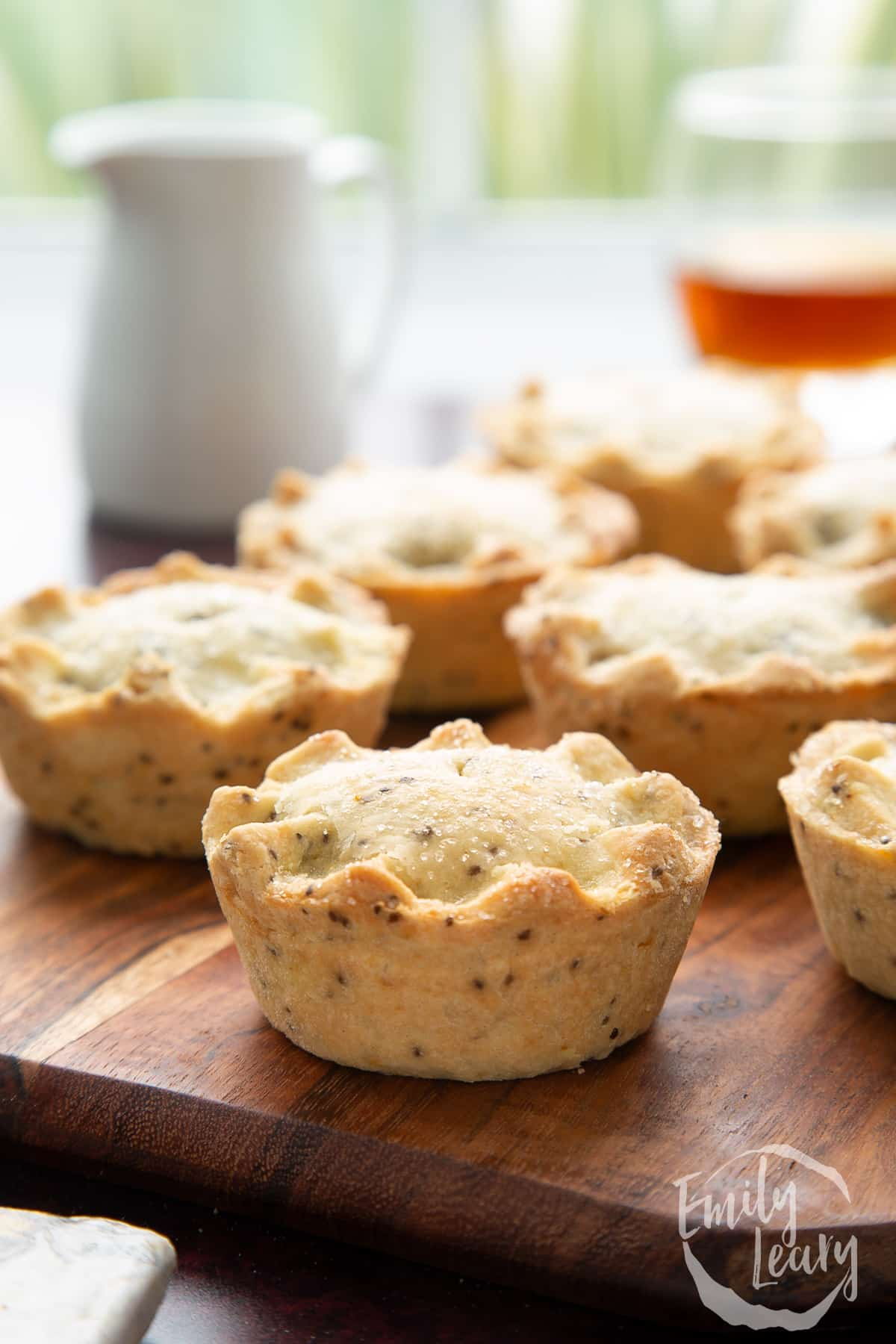 Vegan mince pies on a wooden board.