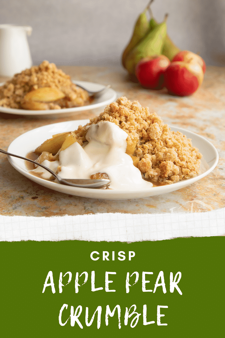 Apple pear crumble and custard served to a small white plate with a spoon. Caption reads: Crisp apple pear crumble.