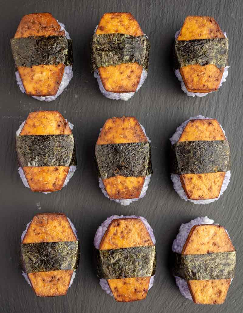 Halloween coffin musubi - a type of such with purple stained rice topped with coffin-shaped slices of tofu.