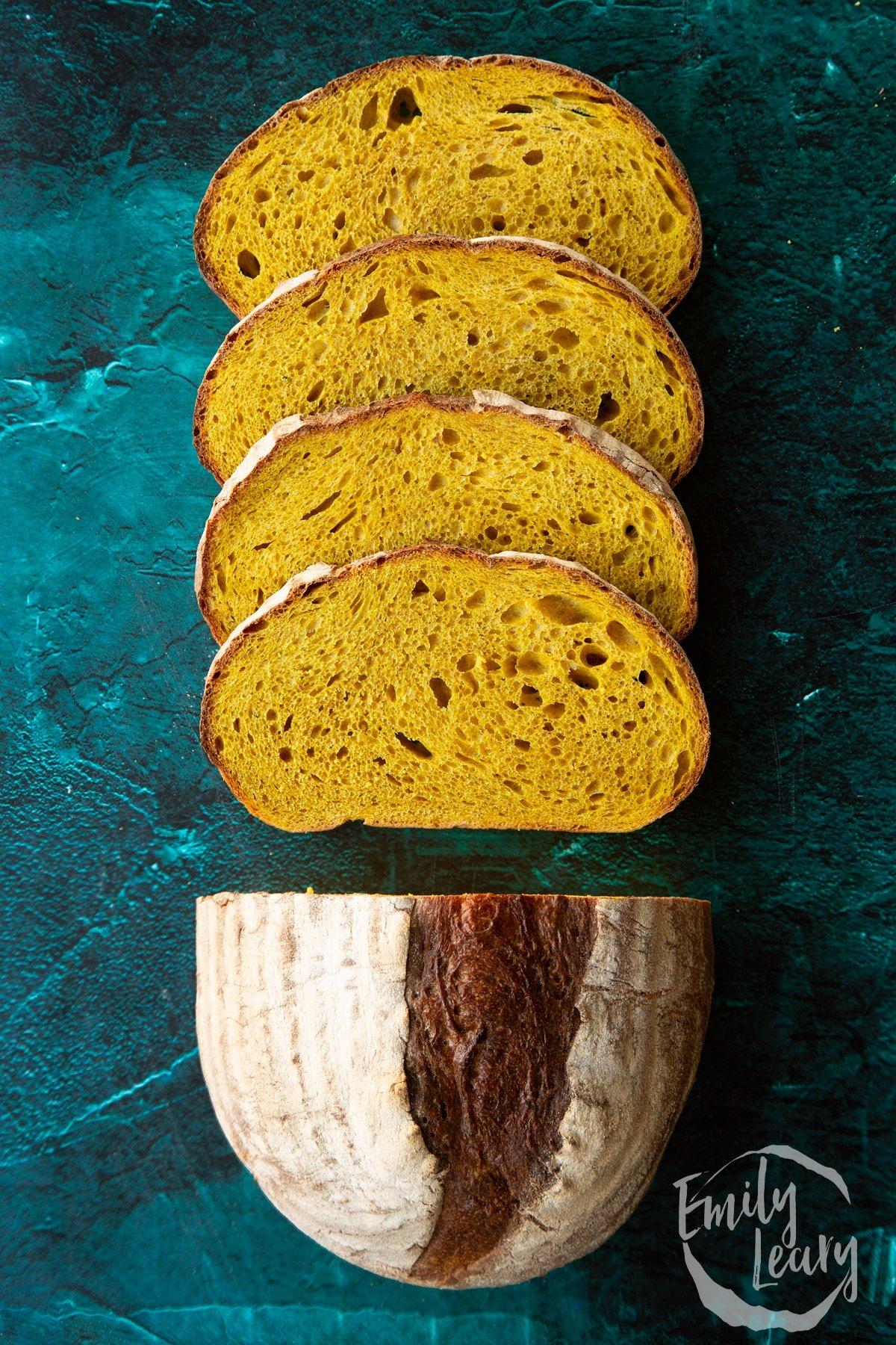 Pumpkin sourdough bread. Some has been cut into slices.