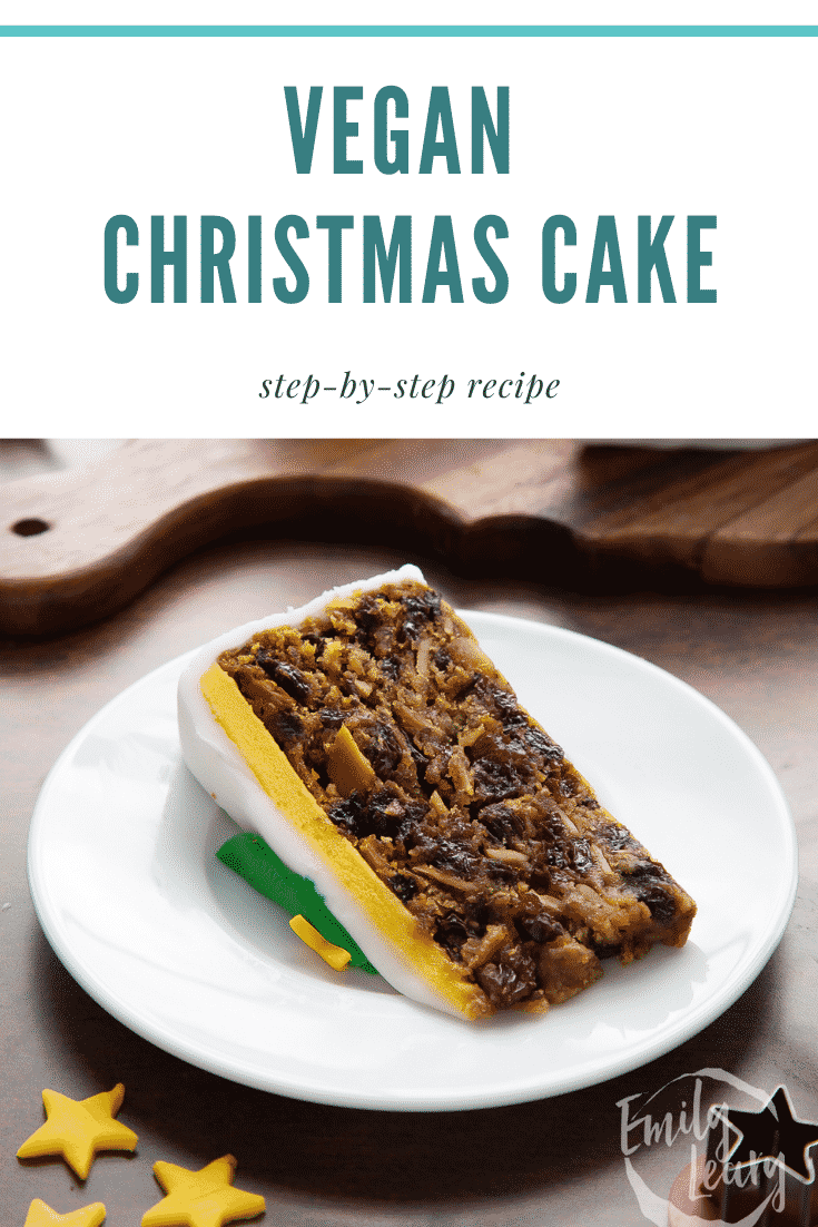 Slice of vegan Christmas cake on a white plate. Caption reads: Vegan Christmas cake. Step-by-step recipe.