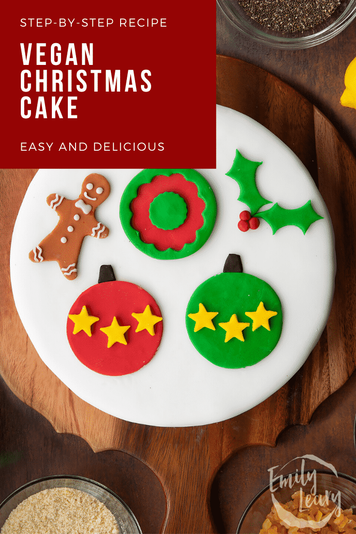 Vegan Christmas cake, decorated with sugar paste decorations. Caption reads: Step-by-step recipe. Vegan Christmas cake. Easy and delicious.