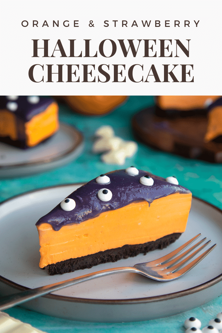 Slice of Halloween cheesecake with an Oreo base on a plate with a fork. Caption reads: Orange & strawberry Halloween cheesecake