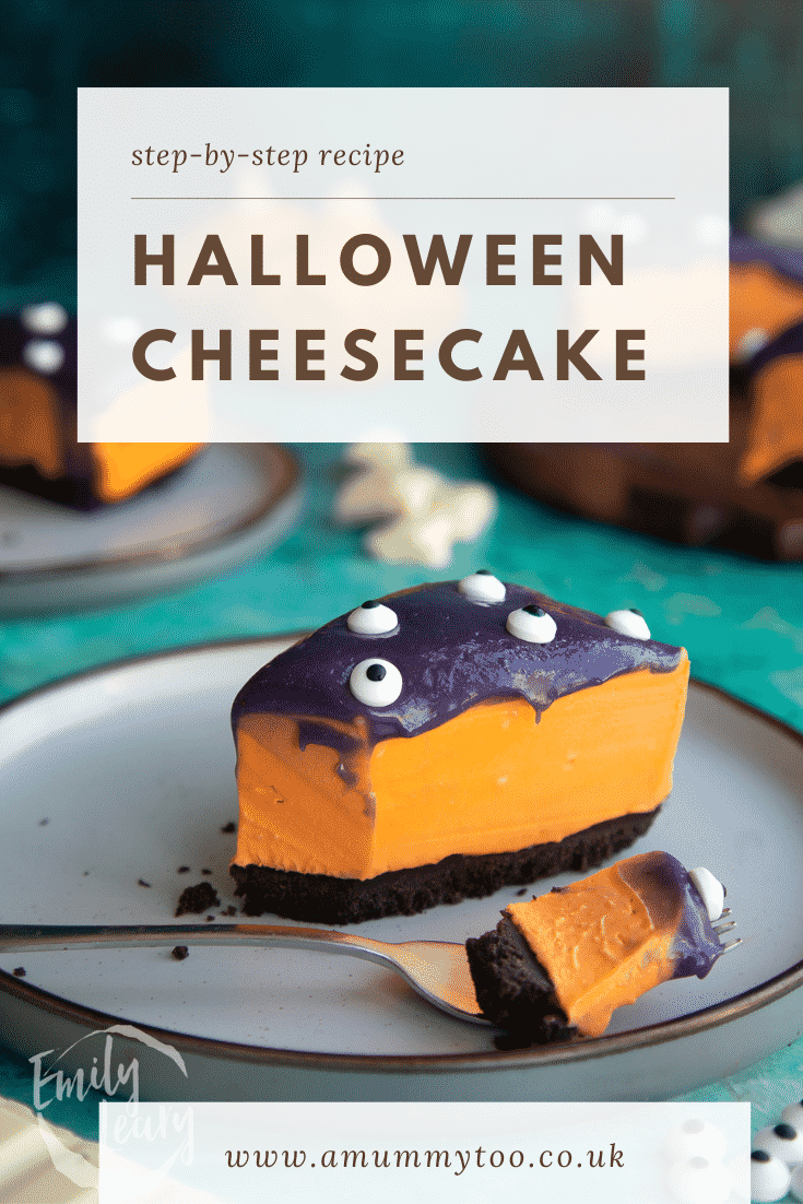 Slice of orange and strawberry Halloween cheesecake with an Oreo base on a plate with a fork, which has taken some. Caption reads: Step-by-step recipe Halloween cheesecake.