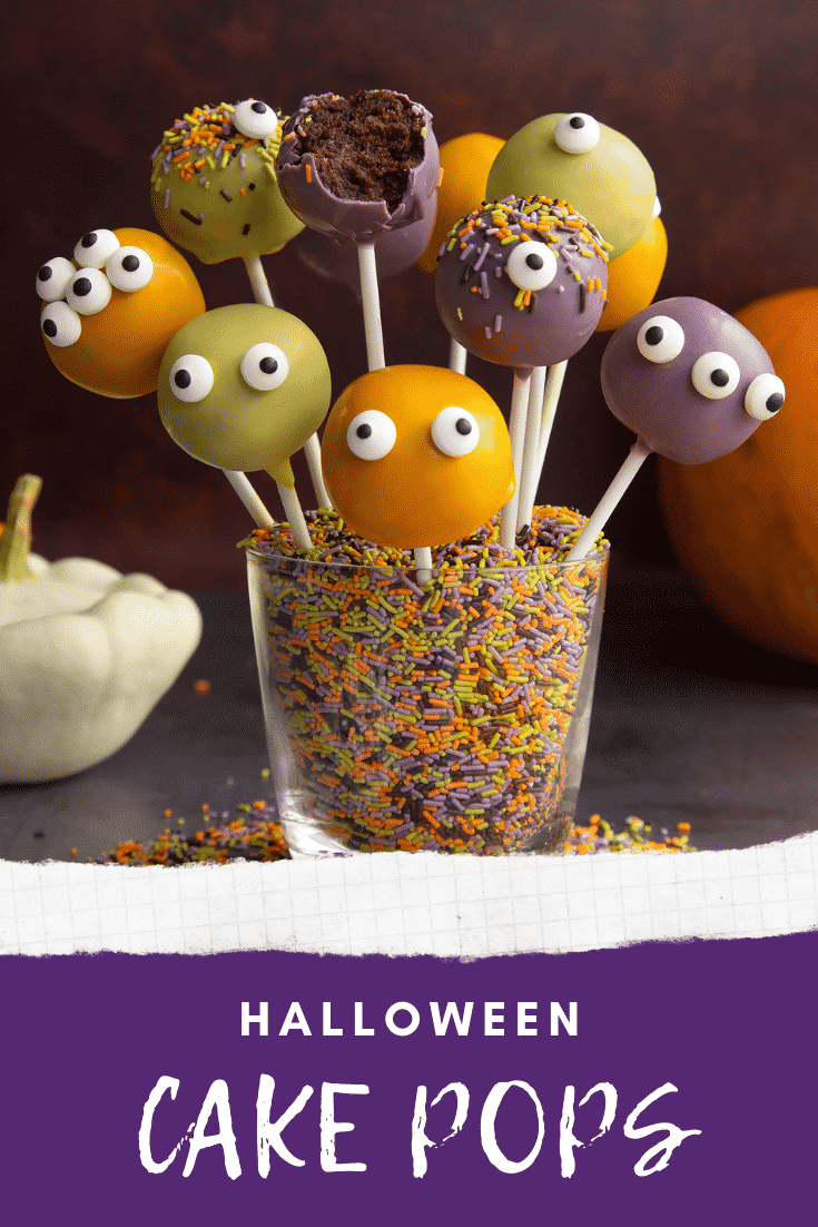 Halloween cake pops standing in a glass filled with Halloween sprinkles. One has been bitten. Caption reads: Halloween cake pops.