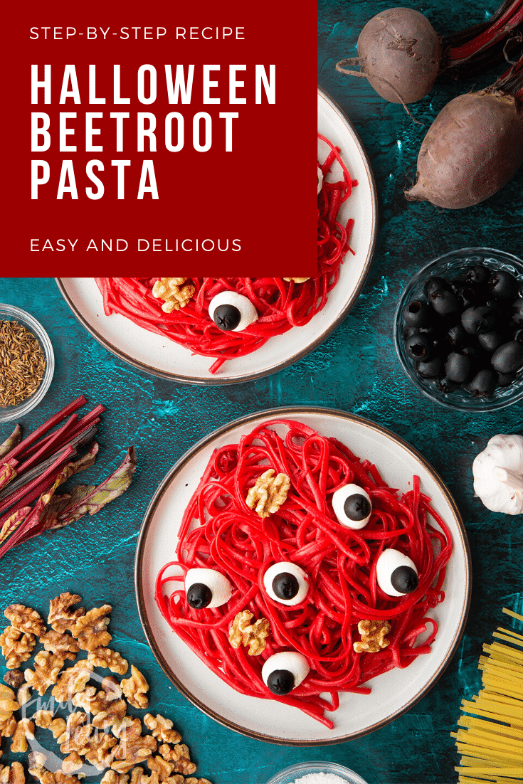 Two plates with a beetroot Halloween pasta recipe, topped with mozzarella eyes and walnut brains. Caption reads: Step-by-step recipe. Halloween beetroot pasta. Easy and delicious.
